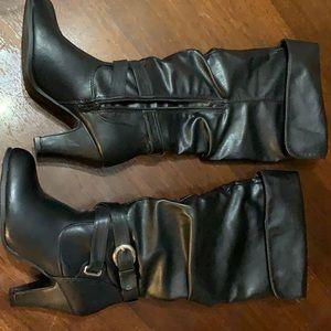 Black knee high heeled boots